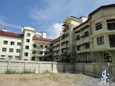 Элитный жилой комплекс утепление и отделка фасада декоративной штукатуркой с архитектурными элементами